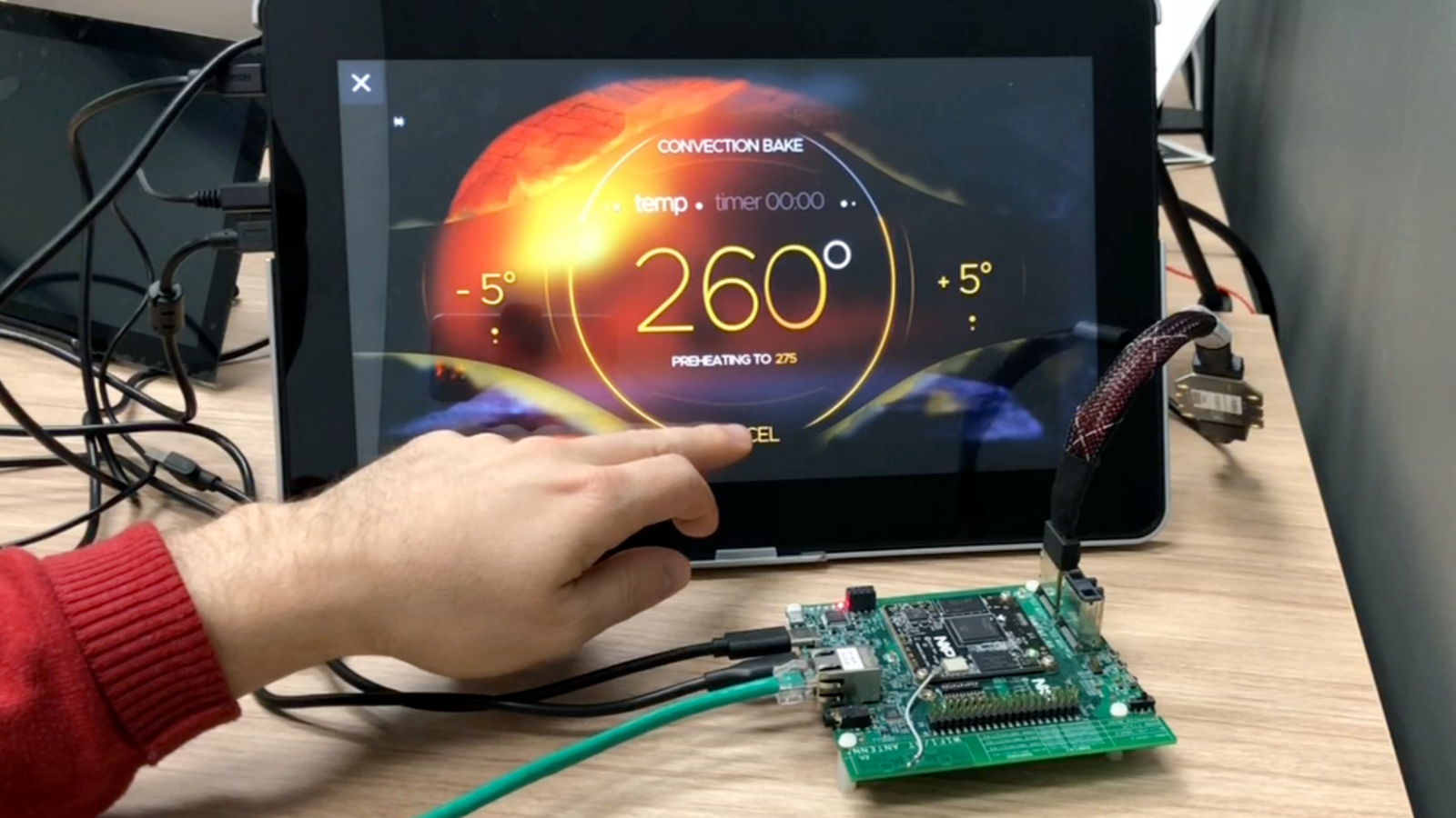 Person using a Storyboard GUI on an NXP i.MX 8M Nano